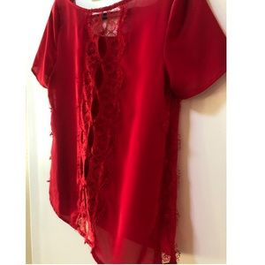 Red blouse with lace detail on back and sides